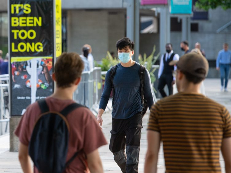 People walk on the South Bank in central London, following the further easing of lockdown restrictions in England (Dominic Lipinski/PA)