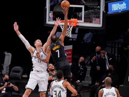 Kevin Durant soars for a basket in the first half of Brooklyn's crushing win over Milwaukee on Monday night (Kathy Willens/AP)