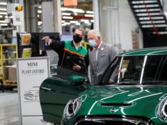 The Prince of Wales speaks to an employee during a visit to the Mini plant in Oxford (Peter Nicholls/PA)
