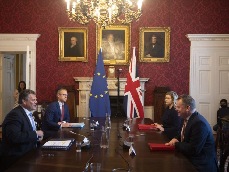 Brexit minister Lord Frost, flanked by Paymaster General Penny Mordaunt, sitting opposite European Commission vice president Maros Sefcovic, who is flanked by Principal Adviser, Service for the EU-UK Agreements (UKS) Richard Szostak, as he chairs the first EU-UK partnership council at Admiralty House in London (Eddie Mulholland/Daily Telegraph/PA)