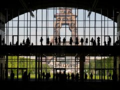 Visitors gather during a presentation visit of the Grand Palais Ephemere, with the Eiffel Tower seen outside (Francois Mori/AP)