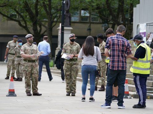Members of the armed forces at a mobile Covid-19 vaccination centre outside Bolton town hall (Peter Byrne/PA)