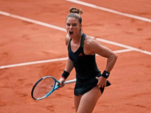 Maria Sakkari defeated defending champion Iga Swiatek (Thibault Camus/AP)