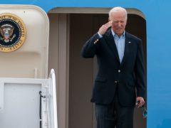 President Joe Biden salutes as he boards Air Force One (Alex Brandon/AP)