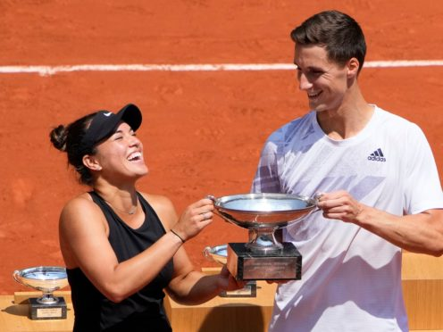 Joe Salisbury, right, and Desirae Krawczyk hold the mixed doubles trophy (Christophe Ena/AP)
