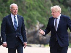 US President Joe Biden talks to Prime Minister Boris Johnson (Toby Melville/PA)