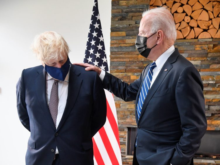US President Joe Biden (right) talks with Prime Minister Boris Johnson, during their meeting in Cornwall (Toby Melville/PA)