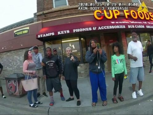 Bystanders including Darnella Frazier, third from right filming, as Derek Chauvin pressed his knee on George Floyd's neck (Minneapolis Police Department via AP, File)