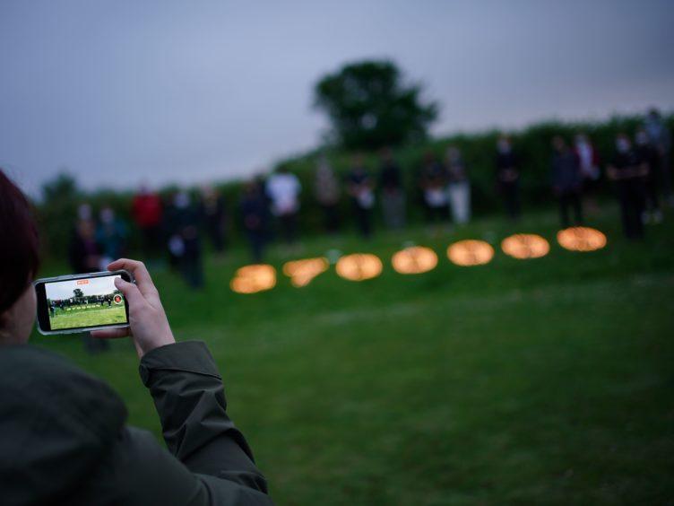 People at a coronavirus vigil in Falmouth (Aaron Chown/PA)