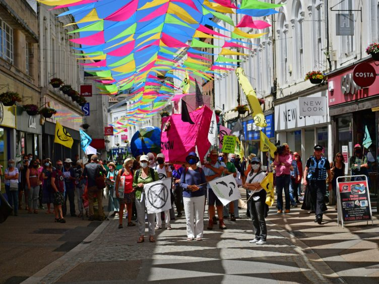 Protesters take part in an XR protest in Falmouth (Ben Birchall/PA)