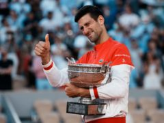 Novak Djokovic gives a thumbs up as he holds the Coupe des Mousquetaires (Thibault Camus/AP)