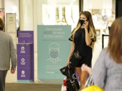 Shoppers alongside Covid-19 signs in Frenchgate shopping centre in Doncaster (Danny Lawson/PA)
