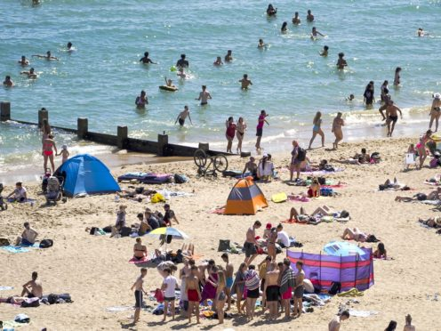 People on the beach in Bournemouth (Steve Parsons/PA)