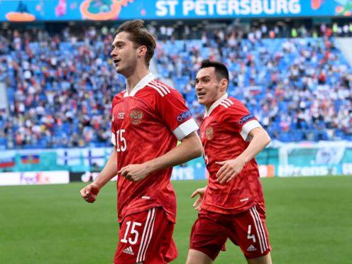 Russia's Aleksei Miranchuk, front, celebrates after scoring the winner against Finland (Kirill Kudryavtsev/Pool AP)
