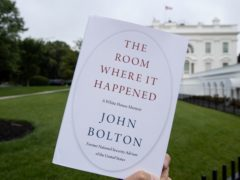 A copy of The Room Where It Happened photographed outside the White House (Alex Brandon/AP)