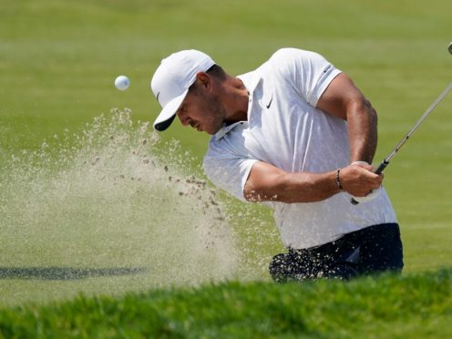 Brooks Koepka carded an opening 69 in the 121st US Open (Marcio Jose Sanchez/AP)