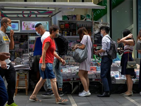 People queue up to buy Apple Daily at a downtown street in Hong Kong on Friday (Vincent Yu/AP)