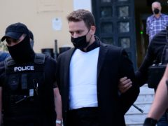 Babis Anagnostopoulos leaves court in Athens after being charged with murdering his British wife (Aggelos Barai/AP)