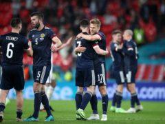 Stuart Armstrong hugs skipper Andy Robertson at Wembley (Nick Potts/PA)