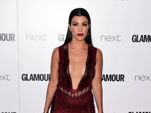 Scott Disick said he gives his 'blessing' to former girlfriend Kourtney Kardashian's new relationship with rock star Travis Barker (Ian West/PA)