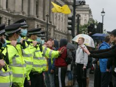 Police officers and protesters at an anti-lockdown protest in Parliament Square, London (Luciana Guerra/PA)