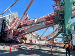A massive crane toppled over at a port in Taiwan (Taiwan International Ports Corporation Ltd/ via AP)