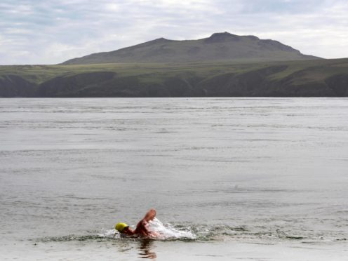 A group of swimmers from Northern Ireland are hopeful they have set a new world record for a relay swim from Ireland to Wales (InfinityChannelSwimming/PA)