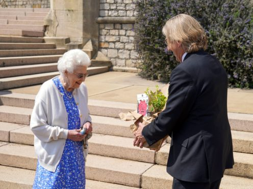 The Queen receives the Duke of Edinburgh Rose from Keith Weed, president of the Royal Horticultural Society (Steve Parsons/PA)