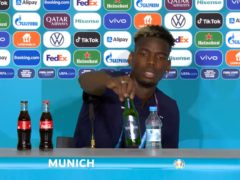 France midfielder Paul Pogba moves a Heineken bottle during a Euro 2020 press conference (UEFA 2021)