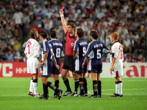 England's David Beckham is given the red card by Danish referee Kim Milton Nielsen, after a foul on Argentina's Diego Simeone during the 1998 World Cup (Adam Butler/PA)