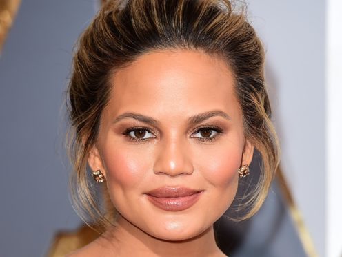 Chrissy Teigen has said her and husband John Legend's dog Pippa 'just died in my arms' (Ian West/PA)