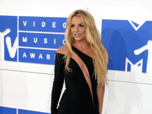 Britney Spears has shared a topless picture to Instagram amid the legal fight to terminate the conservatorship that controls her life and career (PA)