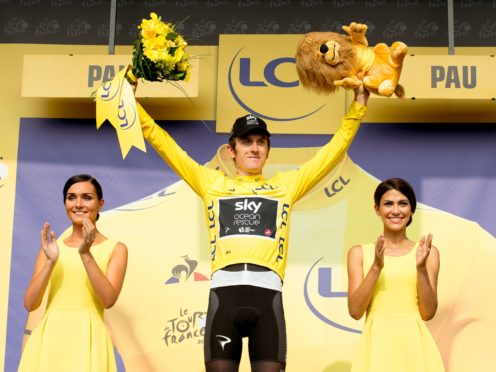 Team Sky's Geraint Thomas celebrates on the podium in the yellow jersey after Stage 18 of the Tour de France 2018. (PA Wire)