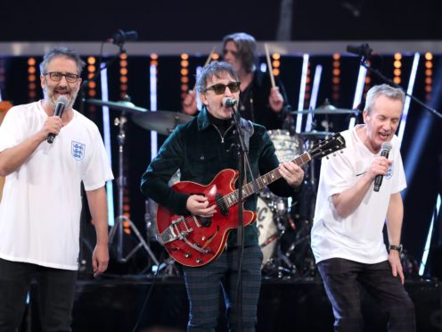 Ian Broudie (centre) of the Lightning Seeds performs with David Baddiel (left) and Frank Skinner (David Davies/PA)