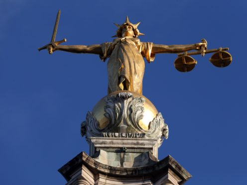 The justice system is at risk of failing due to pressure on legal aid, according to MPs (Jonathan Brady/PA)