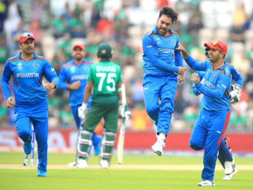 Rashid Khan celebrates taking a wicket for Afghanistan (Adam Davy/PA)