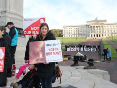 Anti-abortion and Pro Choice activists take part in separate demonstrations in the grounds of Stormont (Niall Carson/PA)