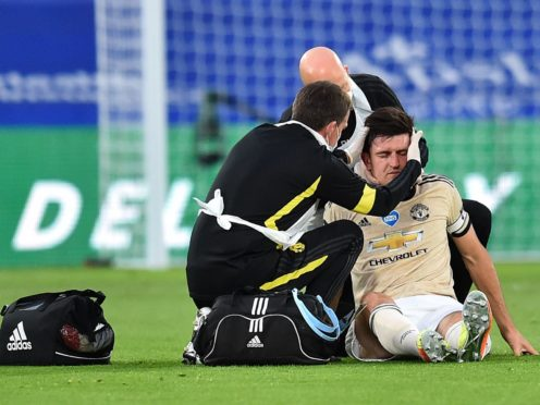 Manchester United's Harry Maguire receives treatment for a head and neck injury on the pitch during a match against Crystal Palace (Glyn Kirk/NMC Pool/PA)