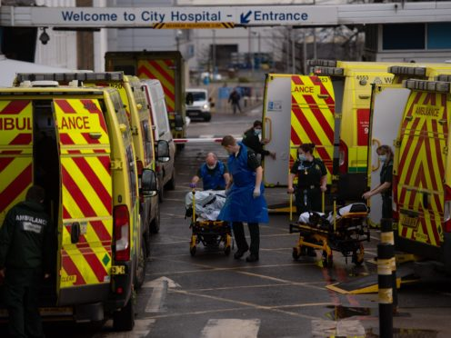 Ambulance crews transport patients into City Hospital in Birmingham at the height of the second wave of coronavirus in January 2021 (Jacob King/PA)
