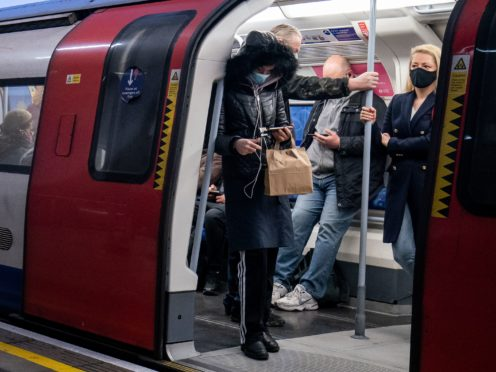 Train operators and Transport for London are cutting services due to staff self-isolating (Aaron Chown/PA)