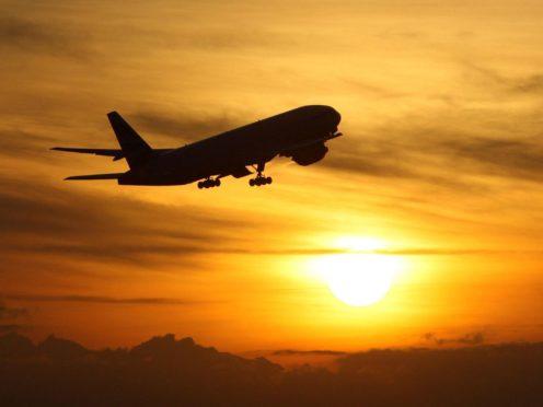 A plane taking off (Steve Parsons/PA)