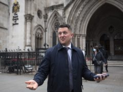 Tommy Robinson outside the Royal Courts of Justice (PA)