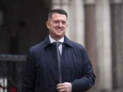 Tommy Robinson leaving the Royal Courts of Justice earlier in the case (PA)