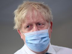 Prime Minister Boris Johnson during a visit to Colchester Hospital in Essex in May 2021 (PA)