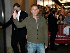 Singer-songwriter Bruce Springsteen exits out the stage door after the Springsteen On Broadway reopening night performance (Evan Agostini/Invision/AP)