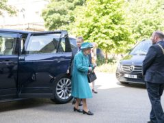The Queen arrives for a visit to the Edinburgh Climate Change Institute (Jane Barlow/PA)