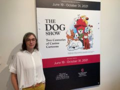 Anne Drozd, museum co-ordinator at Ohio State University's Billy Ireland Cartoon Library Museum, stands at the entrance to the library's new exhibit, The Dog Show (Andrew Welsh-Huggins/AP)