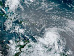 Hurricane Elsa moving through the Caribbean, over Barbados (NOAA/NESDIS/STAR GOES via AP)