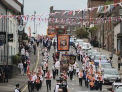 The Orange Order parade in the village of Hillsborough, Co Down (Niall Carson/PA)