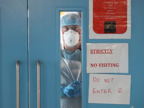 Infection control nurse Colin Clarke looking out from a Covid-19 recovery ward at Craigavon Area Hospital in Co Armagh, Northern Ireland (Niall Carson/PA)